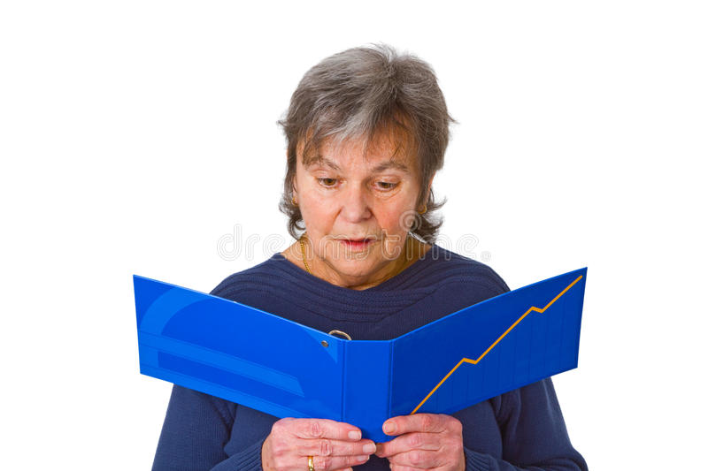 Female senior looking at statement of account stock image
