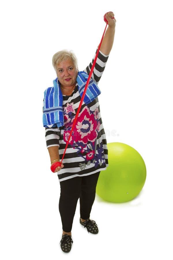 Female senior woman exercises stock photos