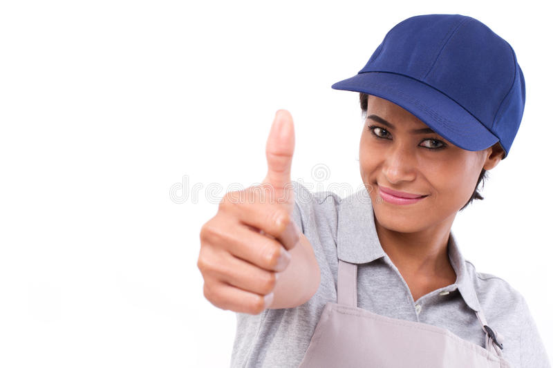 Female service staff giving thumb up. Gesture stock image