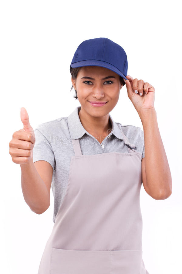 Female service staff showing thumb up hand gesture. White background royalty free stock image