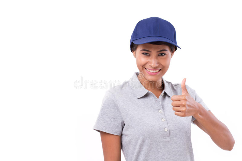 Female service staff showing thumb up hand gesture. White isolated background royalty free stock image