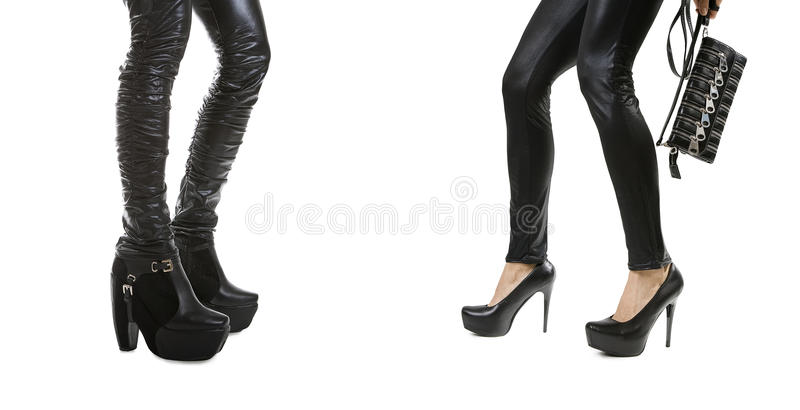 Female legs in stylish black leather boots stock photos