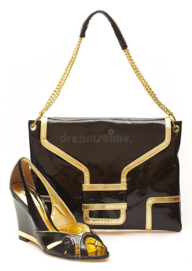Female shoes and handbag stock photos