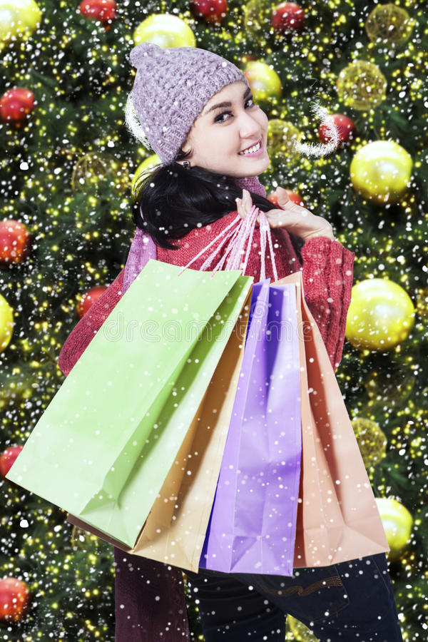 Female shopper carrying shopping bags royalty free stock photos