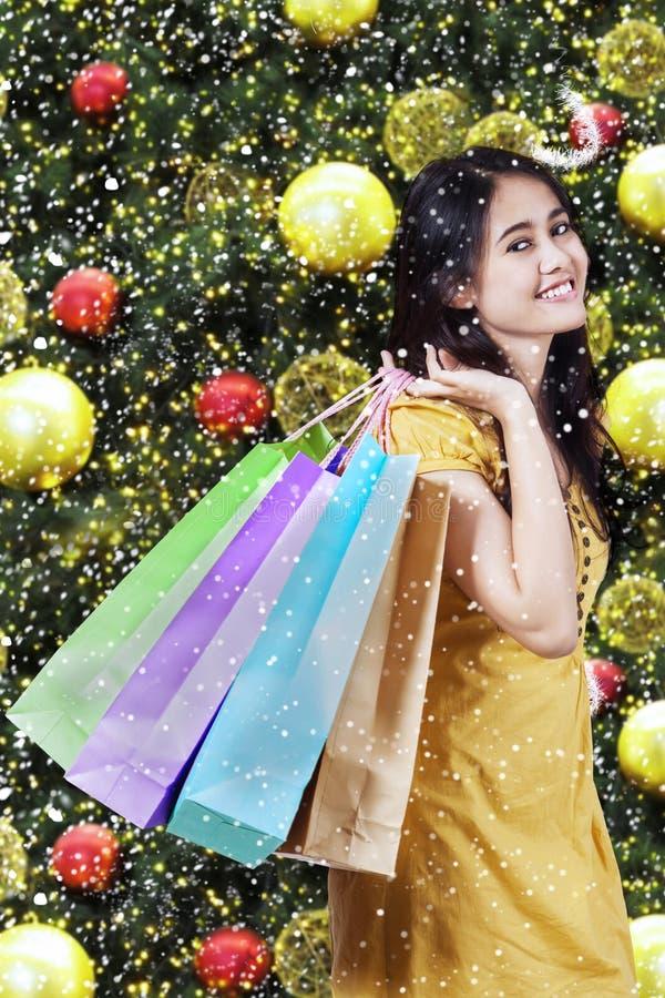 Female shopper with christmas decoration background stock photos