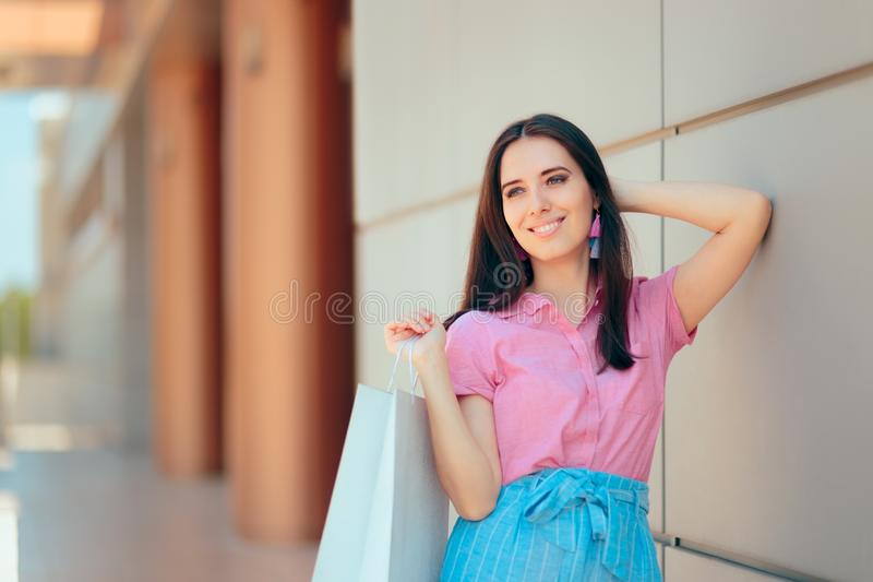 Female Shopper Standing in Front of the Mall stock image