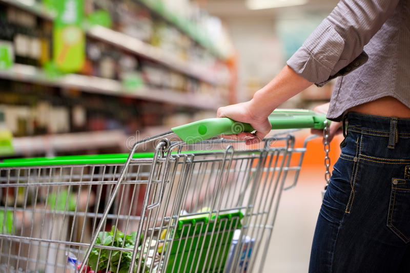 Download Female Shopper With Trolley At Supermarket Stock Image - Image of fashion, customer: 23118993