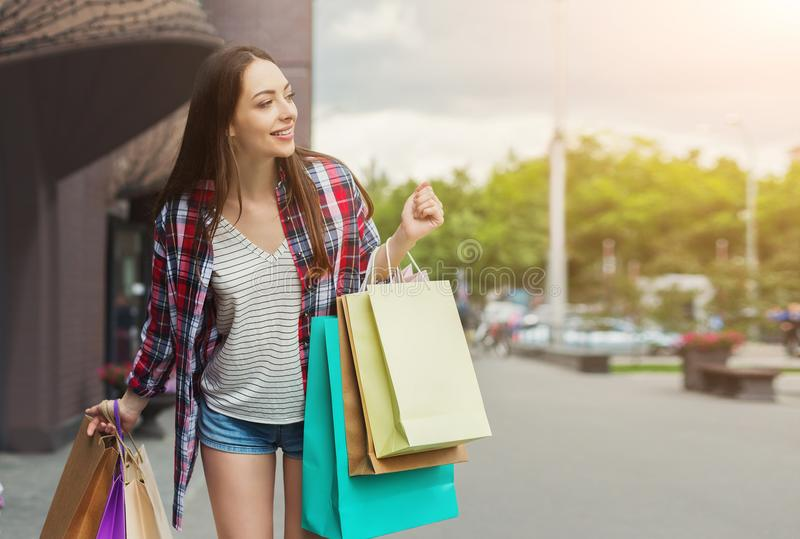 Female shopper walking in city with shopping bags stock photos