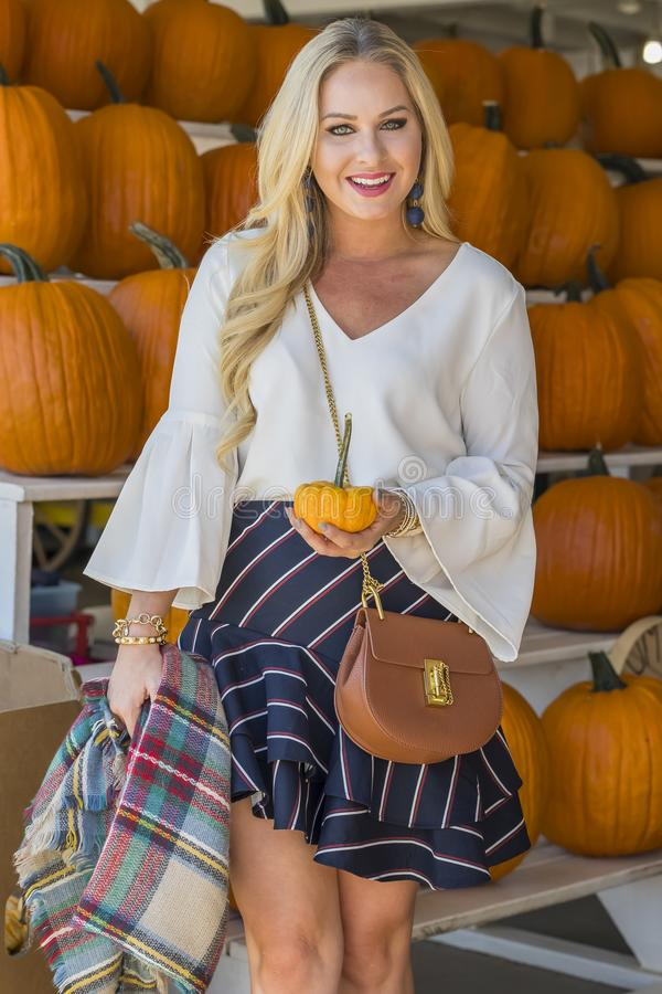 Female Shopping For Halloween Pumpkin royalty free stock photo