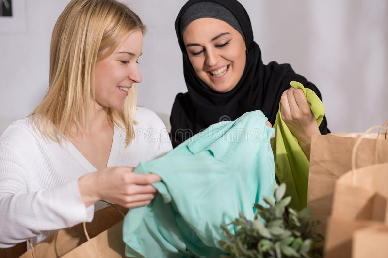Female after shopping with muslim. Picture of happy female after shopping with her muslim friend royalty free stock image