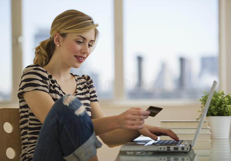 Female shopping online from home. Female with credit card shopping online from home stock photography