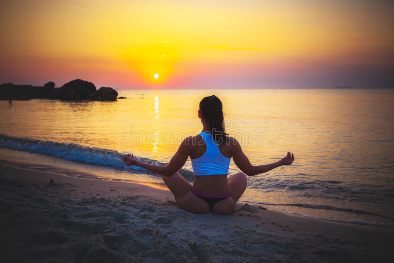Download Female Silhouette In Yoga Meditation Pose Stock Image