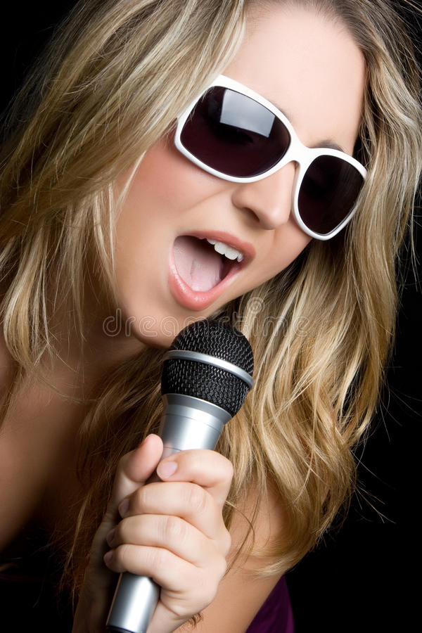 Female Singer. Female karaoke singer with microphone stock photography