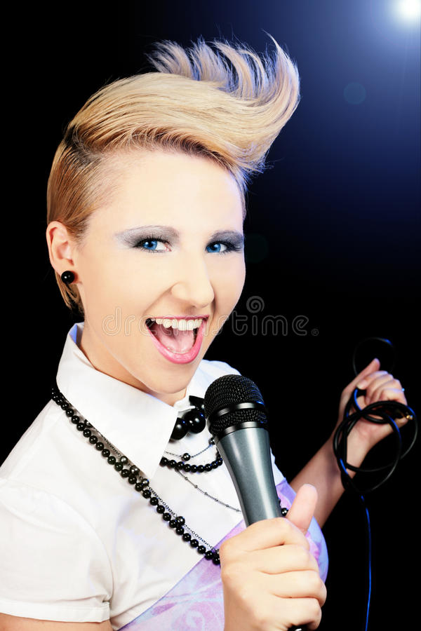Female singer. With special hair cut stock images
