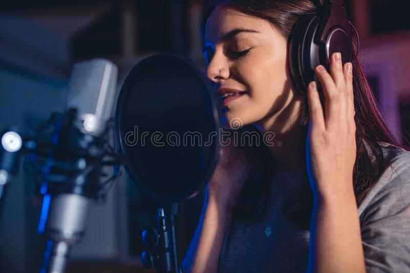 Female singer in recording studio royalty free stock images