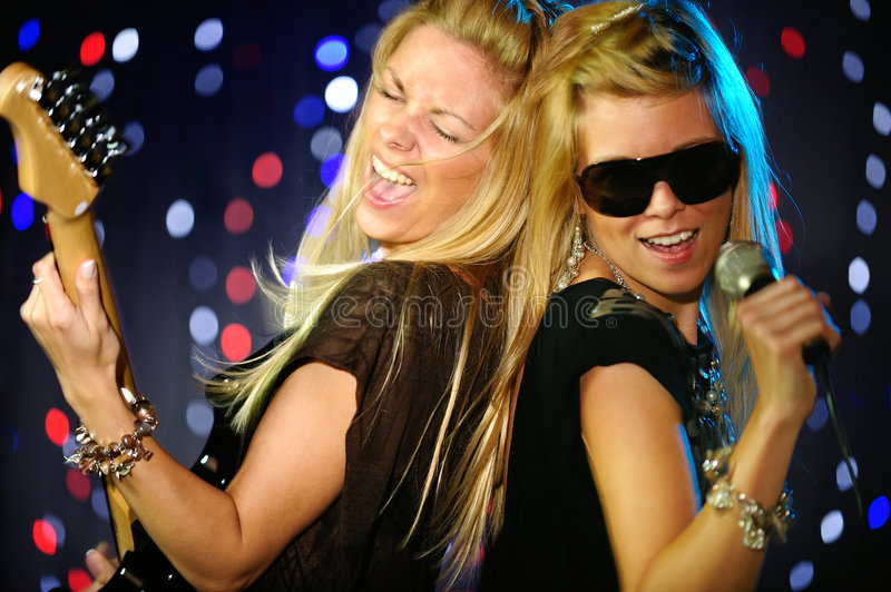 Female singer and guitar player. Rock out stock photography