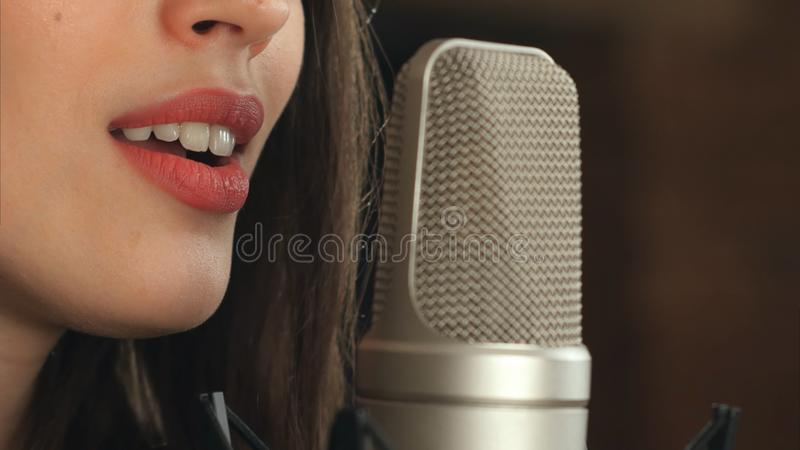 Female singer and microphone stock images
