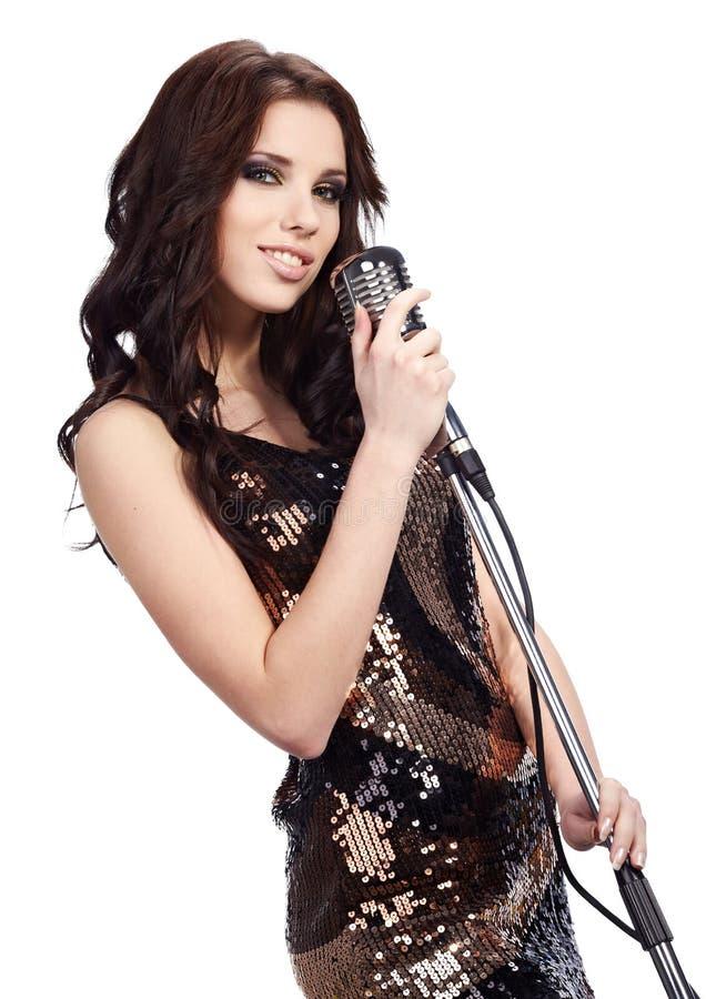 Female singer with the retro mic. Pop female singer with the retro microphone royalty free stock image