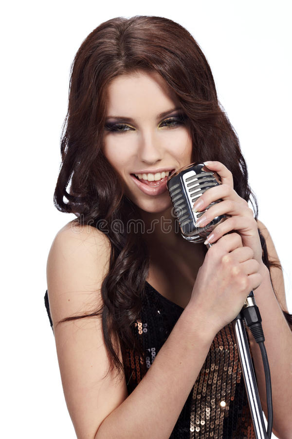 Female singer with the retro mic. Pop female singer with the retro microphone royalty free stock photography