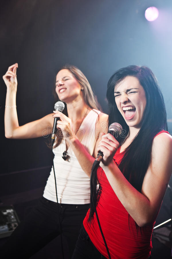 Female singers performing. On stage royalty free stock photography