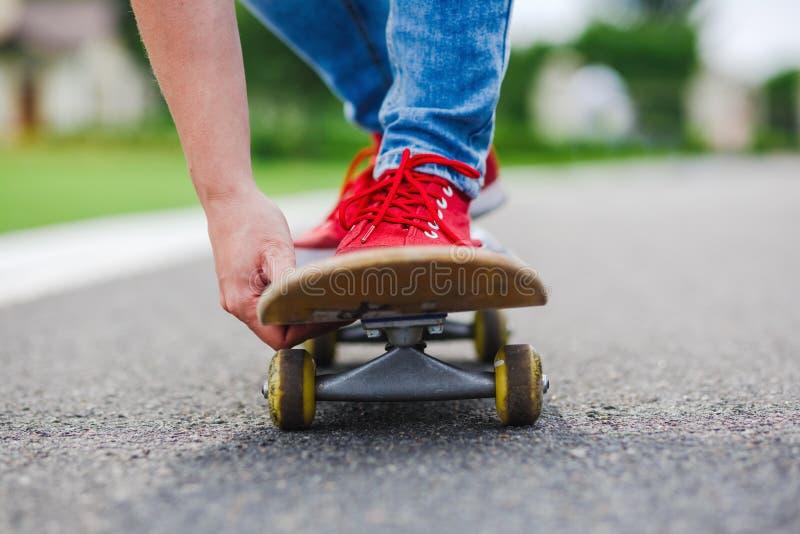 Skateboarder riding skateboard through the street stock photo