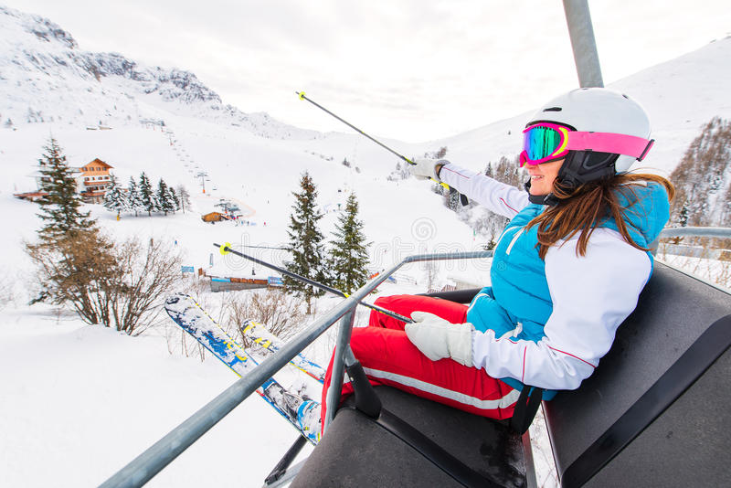 Female skier chair lift in ski area royalty free stock photo