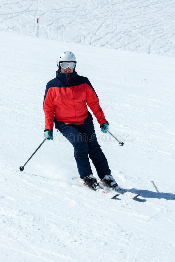 Female skier in downhill slope. Winter sport recreational activity royalty free stock photography