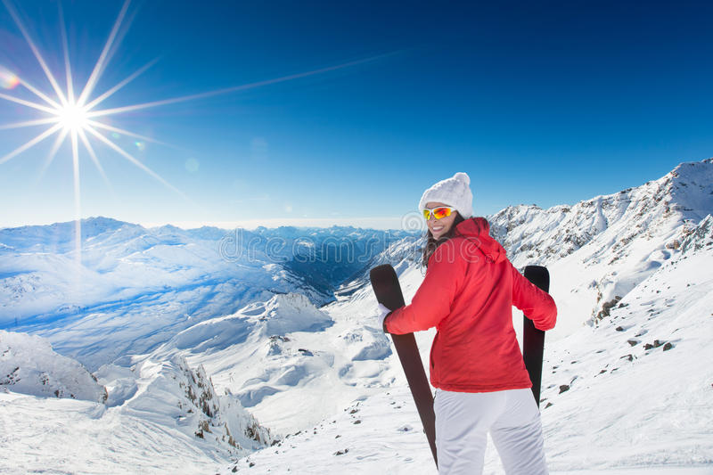 A female skier on the piste. royalty free stock photography