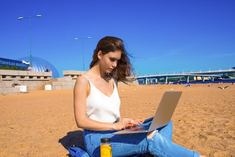 Female skilled writer keyboarding on notebook. Girl having distance work via netbook stock photo