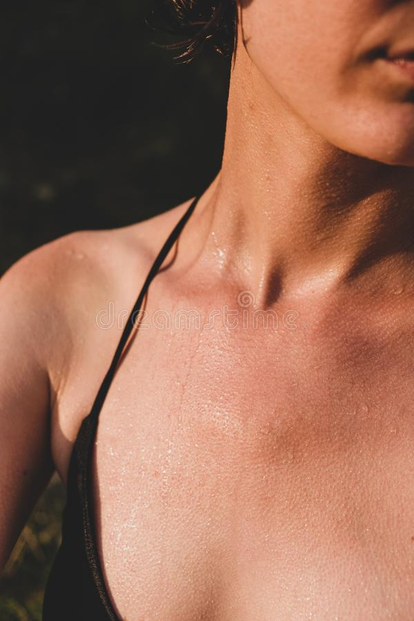 Female skin wet and with goosebumps from swimming in cold water. stock photography