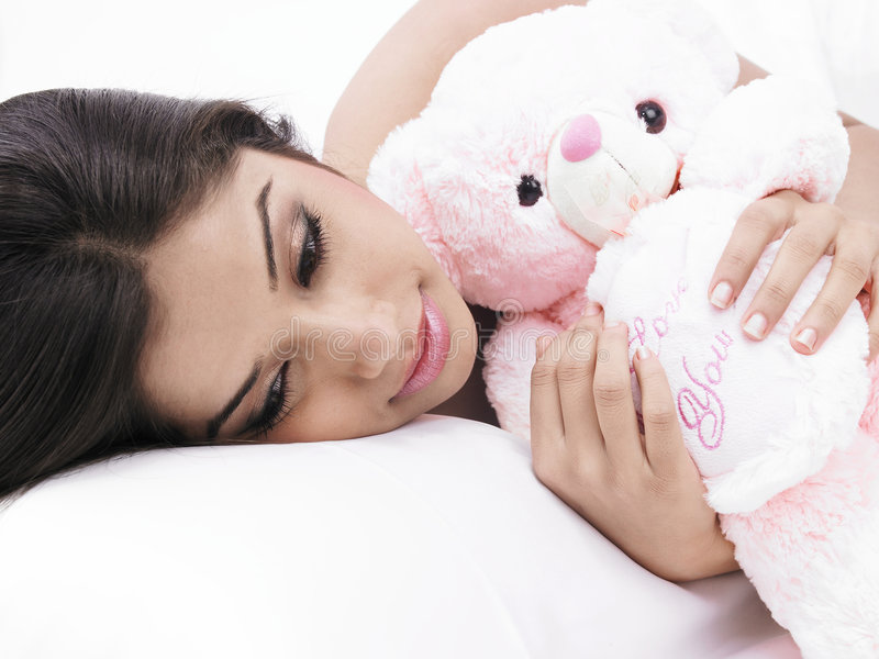 Female Sleeping With Her Teddy Royalty Free Stock Photos