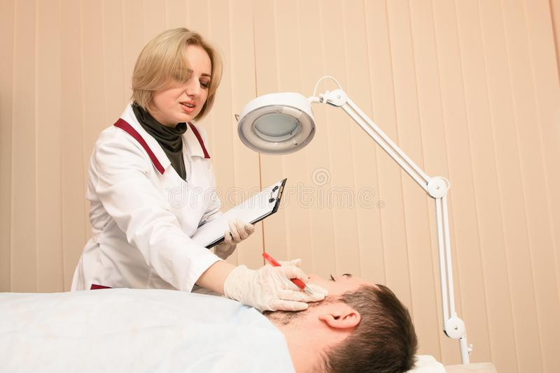 Female smiling doctor notice patient symptoms in paper royalty free stock photography
