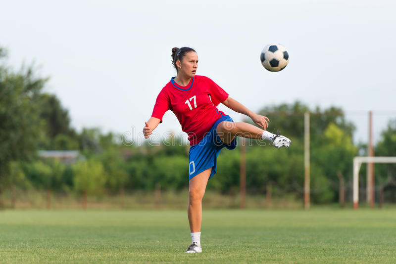 Female soccer. Player on the field royalty free stock image