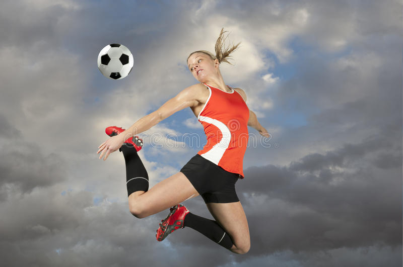 Female Soccer Player Kicking a Ball royalty free stock photography