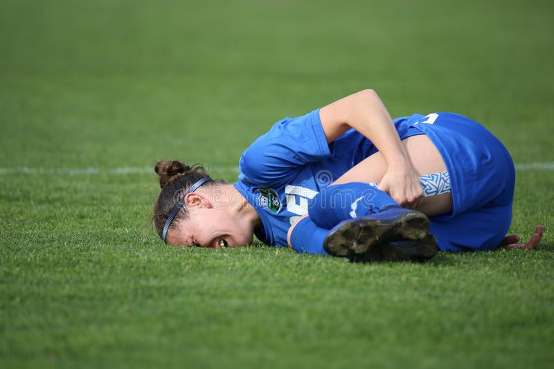 A female soccer player lying on the ground in pain royalty free stock photos