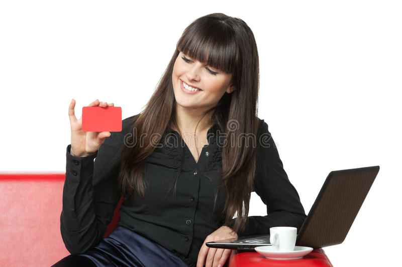Female On Sofa Going To Make Online Purchases Stock Photo