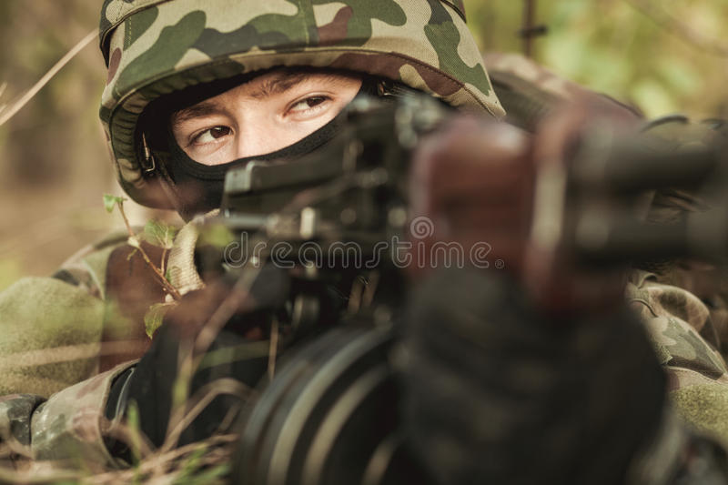 Female soldier in the battlefield. Close-up of female soldier in the battlefield royalty free stock image