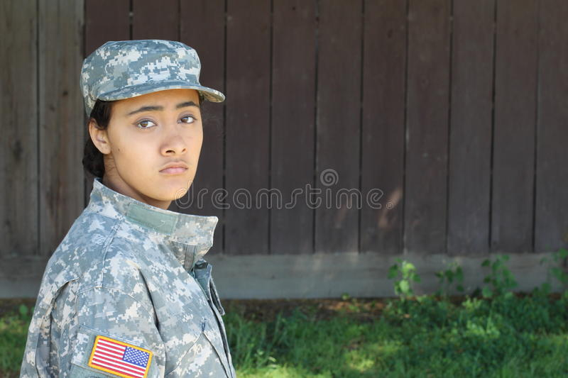 Female soldier on the nature background stock images