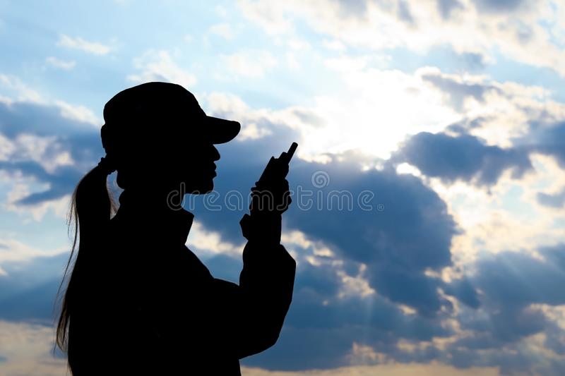 Female soldier with portable radio. Military service stock images