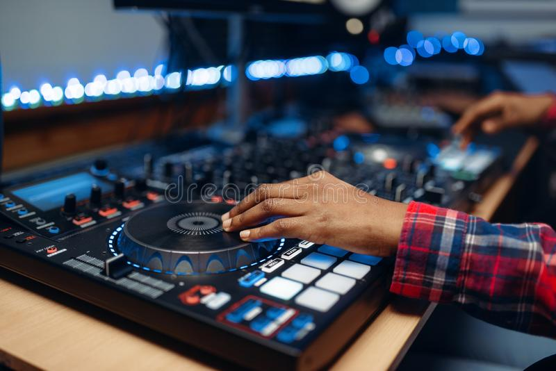 Female sound operator in audio recording studio stock image