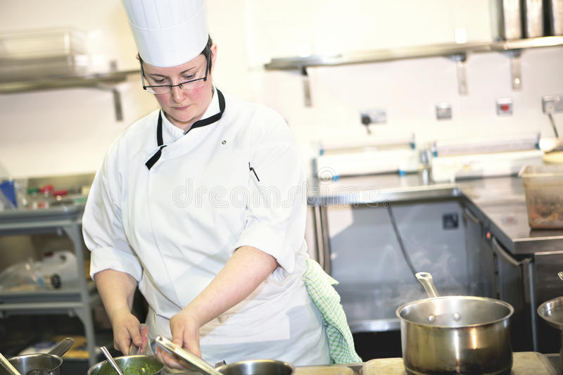 Female Sous Chef Cooking Royalty Free Stock Images
