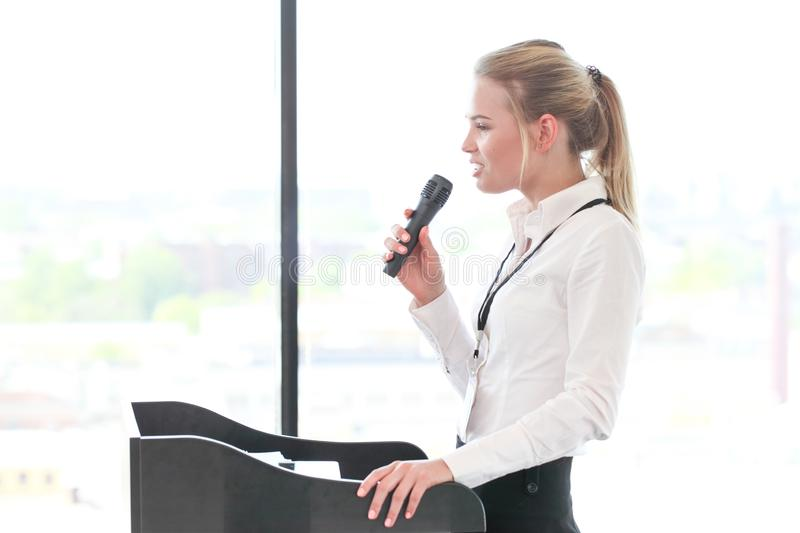 Female speaker at conference royalty free stock images