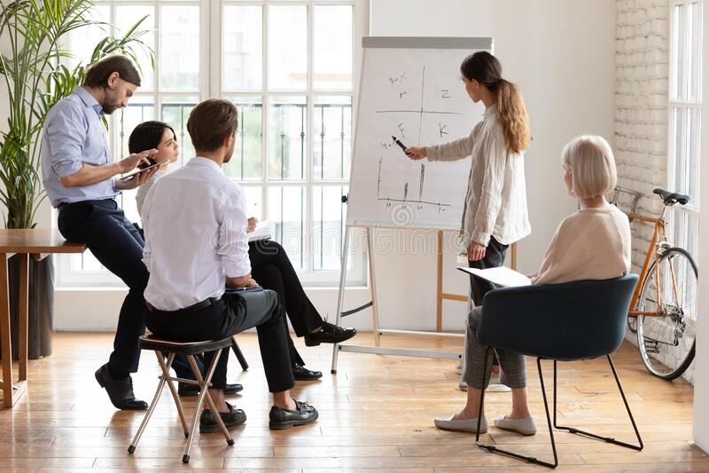 Female speaker make flip chart presentation for colleagues stock photos