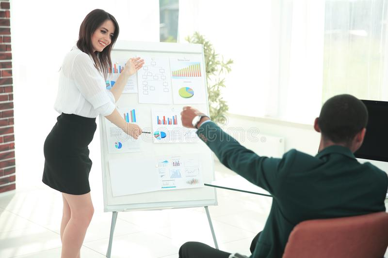 Female speaker making a presentation of a new project. stock photo