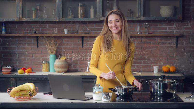 Female speaking cook lunch in apartment. royalty free stock images