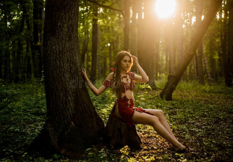Female spirit mythology. Wilderness of virgin woods. She belongs tribe warrior women. Wild attractive woman in forest. Folklore character. Living wild life royalty free stock photo