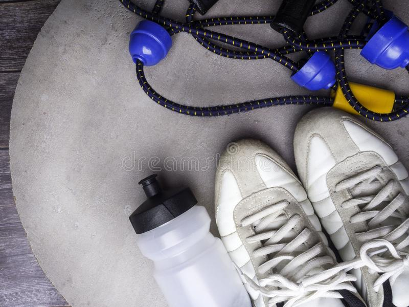 Female sport shoes and equipment top view, copy space. Active lifestyle, body care concept royalty free stock photos