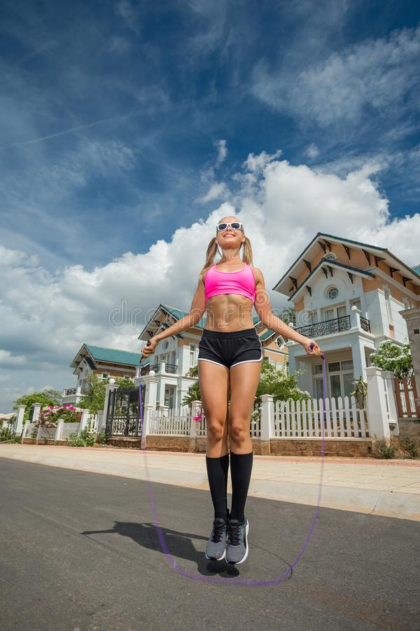Female sports model exercising outdoor in summer. stock photography