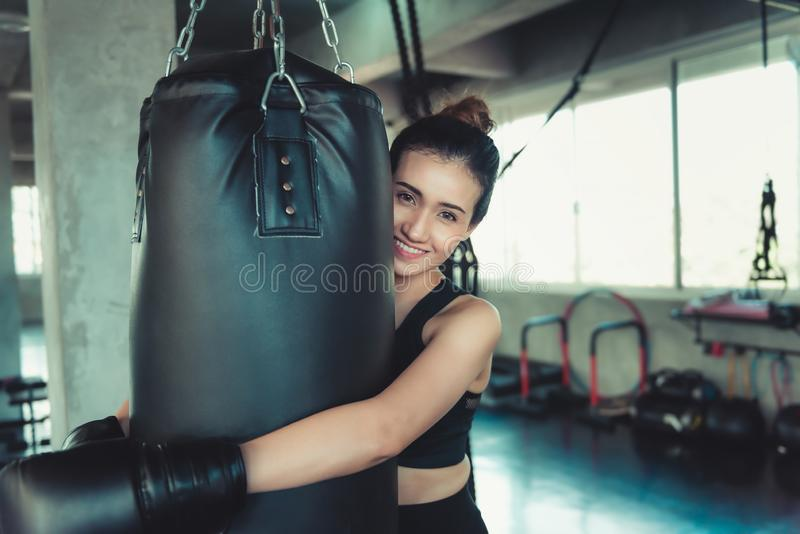 Female Sporty Boxer is Exercised Training Punching in Fitness Club, Portrait of Boxer Woman With Boxing Bag Posing. Beautiful of royalty free stock images