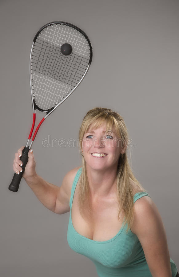 Female squash player with raquet and ball royalty free stock image